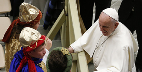 Pope Francis greets children dressed as the Three Kings during his general audience in Paul VI hall at the Vatican yesterday (CNS/Paul Haring)