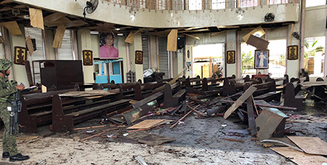 The bomb-damaged Cathedral of Our Lady of Mount Carmel in Jolo (CNS/Philippines Armed Forces via Reuters)