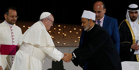Pope Francis shakes hands with Sheik Ahmad el-Tayebat an interreligious meeting in Abu Dhabi yesterday (CNS/Paul Haring)