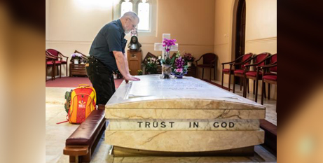 American pilgrim Ricky Peterson prays at the tomb of St Mary MacKillop in North Sydney (CNS/Giovanni Portelli/The Catholic Weekly)