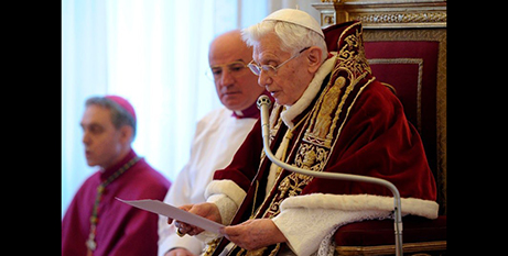 Pope Benedict XVI reads his resignation letter during a meeting of cardinals at the Vatican on February 11, 2013 (CNS/L'Osservatore Romano)