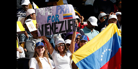 A woman appeals for prayers for Venezuela at the papal Mass in Abu Dhabi earlier this month (CNS/Paul Haring)