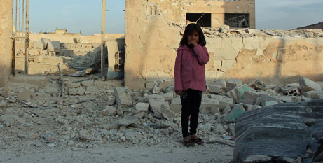 A young Syrian girl amidst the rubble of the crisis (UNICEF)