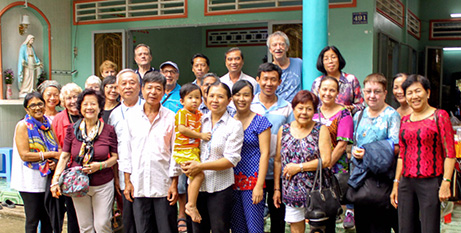 Group photo outside the village home of Fr Francis Ly in My Tho, Vietnam (George Favacho)
