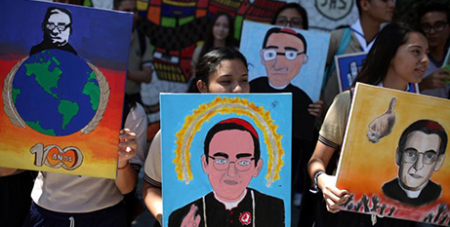 Students hold paintings of Blessed Oscar Romero in San Salvador, El Salvador (CNS/Jose Cabezas)