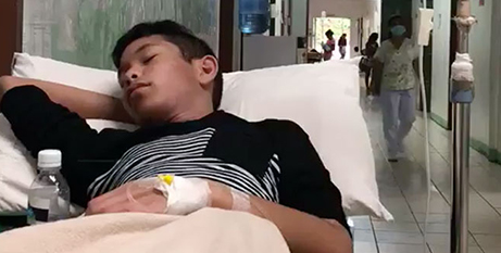 Miguel Balagtas in the Coron District Hospital corridor awaiting treatment (Supplied)