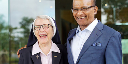 Sr Angela Mary Doyle with Springfield City Group chairman Maha Sinnathamby at the International Women's Day event (The Catholic Leader)