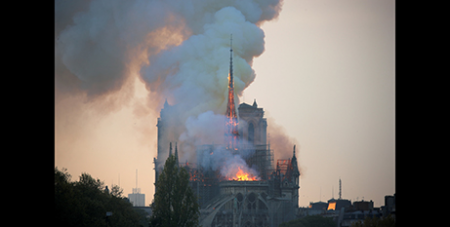 Flames and smoke billow from the Notre Dame Cathedral in Paris this morning (CNS/Charles Platiau, Reuters)