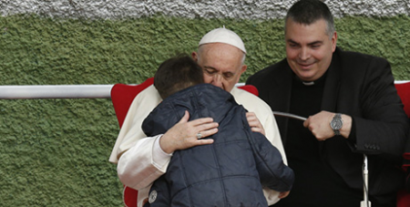 Pope Francis embraces Emanuele (CNS/Paul Haring)