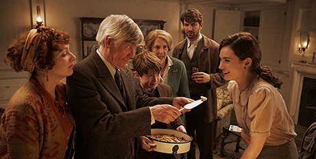 Lily James, right, and the cast of The Guernsey Literary and Potato Peel Pie Society (IMDB/Kerry Brown)