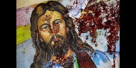 A blood-spattered painting of Jesus inside a Coptic Christian church in Egypt (CNS)