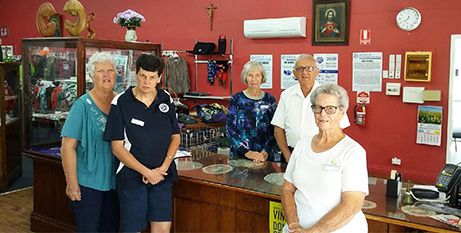 Beverley Moore (far right), husband Brian (second from right) with their Vinnies' friends (The Catholic Leader)