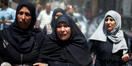 Mourners at the funeral of the eight-month-old baby who died after inhaling tear gas at the Israel-Gaza border (CNS)