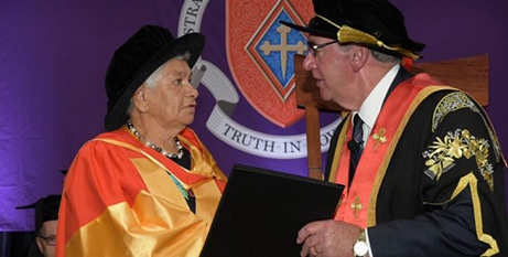 Aunty Fay Green receives her doctorate from ACU Chancellor John Fahey (GFP Graduations)