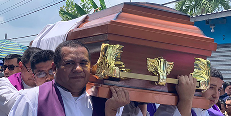 Priests carry the casket of Fr Cecilio Perez Cruz at his funeral in Sonzacate, El Salvador on Monday (CNS/Fr Edwin Banos)