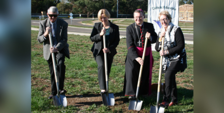 Fr Peter Slater, Mikaela Power, Bishop Patrick O'Regan and Maria Kirkwood turn the sod at the new school site (Sale Diocese)