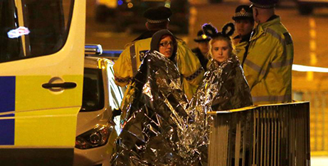 Concertgoers wrapped in thermal blankets after the bombing (CNS photo/Jon Super, Reuters)