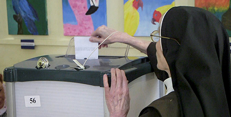 A sister casts her vote in the Irish referendum in Dublin, Friday (CNS/Alex Fraser, Reuters)