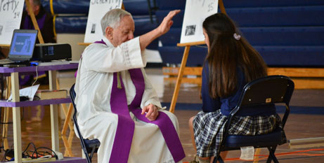 Priest hears a confession (CNS)