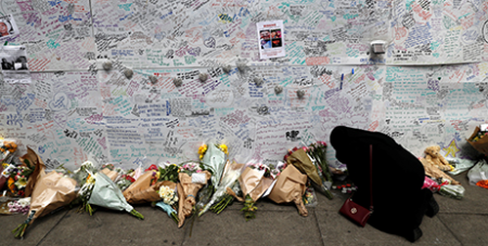A memorial wall for the Grenfell Tower victims (CNS/Stefan Wermuth, Reuters)