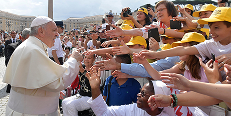Pope Francis greets the crowd at the general audience yesterday (Vatican Media)