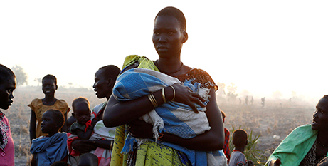 A South Sudanese woman waits to register for a food program (CNS)