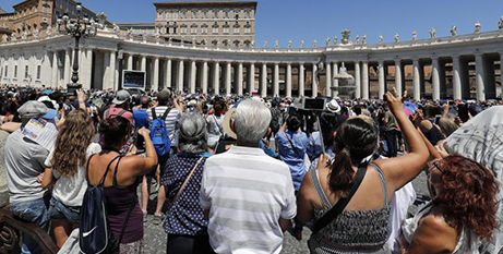 Pope Francis leads the Angelus from his balcony at the Vatican on Sunday (CNS/Riccardo Antimani/EPA)