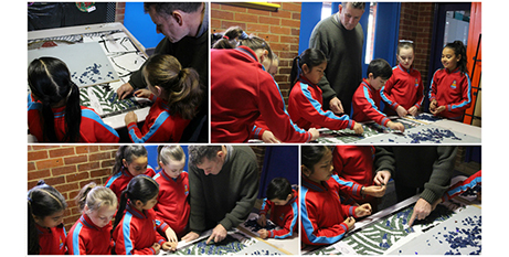 Simon Normand and St Pius X students work on the mural (Melbourne Catholic)