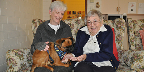Tully sits on Teresa Rose's lap during a visit with Sr Teresa Daly (Supplied)
