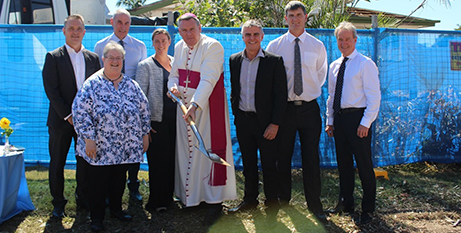 Bishop Tim Harris, with Mater representatives, turns the first sod for the hospital expansion (Mater)
