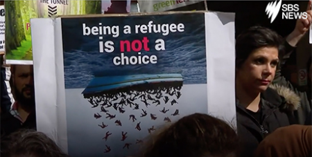 A rally for refugees in Sydney yesterday (SBS News screenshot)
