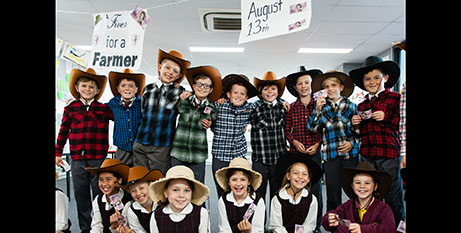 Jack Berne (centre) and with school mates dress up to raise money for drought-affected farmers (Fiver For A Farmer)
