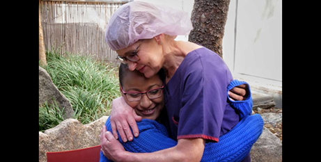 Hare Haro hugs nurse Tracey Foster (ABC News/Dylan Anderson)
