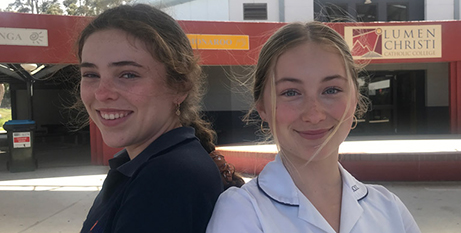 Julia Cullenward (left) and Ambrosia Kleber are two of the four students that made the video (Catholic Voice)