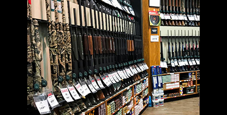 Rifles are seen inside the gun section of a  US sporting goods store (CNS/Eduardo Munoz/Reuters)