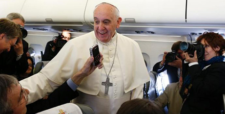 Pope Francis greets journalists on the papal plane (CNS/Paul Haring)