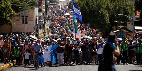 The caravan of migrants from Central America marching towards the United States (CNS/Ueslei Marclino, Reuters)