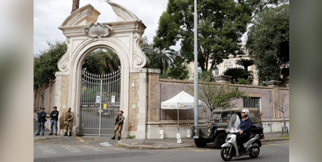 Italian army and police officers stand in front of the apostolic nunciature where the bones were discovered last week (CNS/Stefano Rellandini, Reuters)