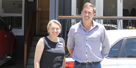 Cornerstone staff Michael Eklom (right) and Melissa outside their Gold Coast office (The Catholic Leader)