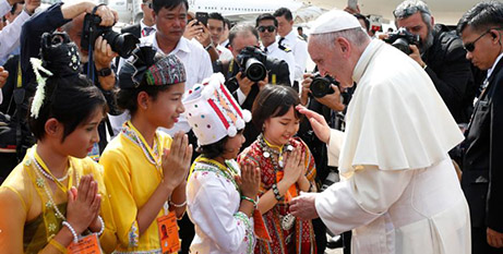 Pope Francis greets children at Yangon airport yesterday (CNS/PaulHaring)