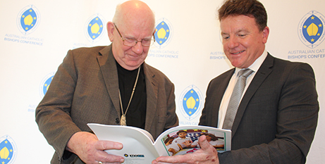 Bishop Gerard Holohan and acting ACCER chair Tony Farley with the report (ACBC)