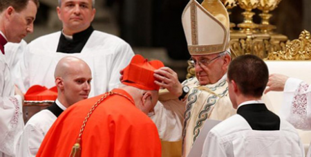 Cardinal Anders Arborelius receives his red biretta from Pope Francis (CNS/Paul Haring)