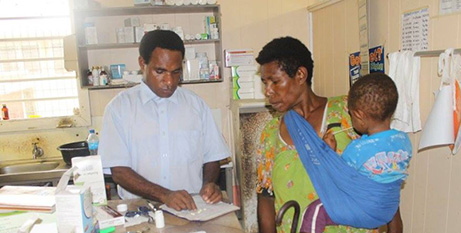 A church health worker with a patient in PNG (Christian Health Services)