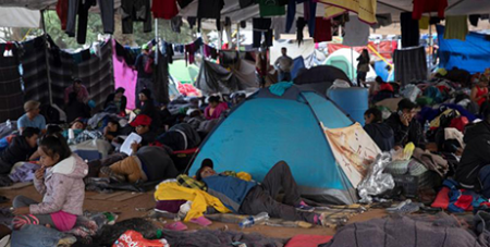 Migrants from Central America trying to reach the United States in a makeshift camp in Mexico (CNS/Alkis Konstantinidis, Reuters)