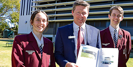 Mt Maria College principal Glenn McConville, with students Teresa Rampa Dowling and James Orman, with a school energy report (The Catholic Leader)