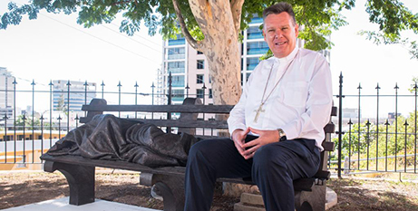 Bishop Timothy Harris with Homeless Jesus (Neil Helmore)