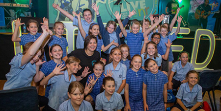 Gen Bryant (centre) with students from St Thomas Aquinas Primary School Springwood at LIFTED Live Jr (Parramatta Diocese)
