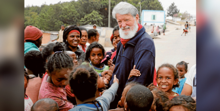 Fr Pedro Opeka with children from Madagascar