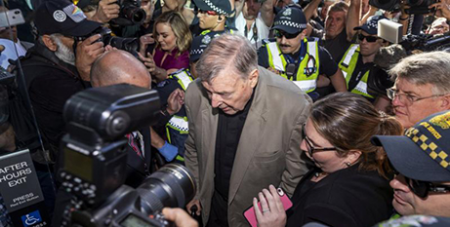 Cardinal George Pell arrives at the Melbourne County Court in February (CNS/Daniel Pockett, AAP via Reuters)