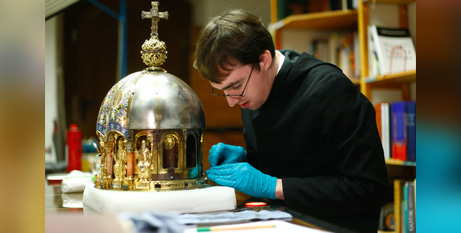 A restorer cleans the reliquary of St Corona at the cathedral in Aachen, Germany, on Wednesday (CNS/Thilo Schmuelgen, Reuters)